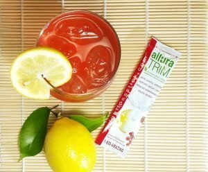 Allura Trim Fitness Stick is perfect in a cup of water, ice, and a side lemon.